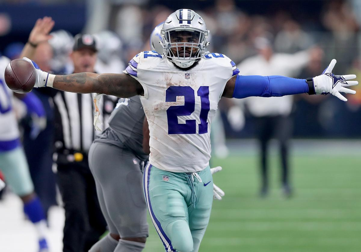 Ezekiel Elliott #21 of the Dallas Cowboys reacts after completing a pass against Jarrad Davis #40 of the Detroit Lions in the fourth quarter at AT&T Stadium on September 30, 2018 in Arlington, Texas.