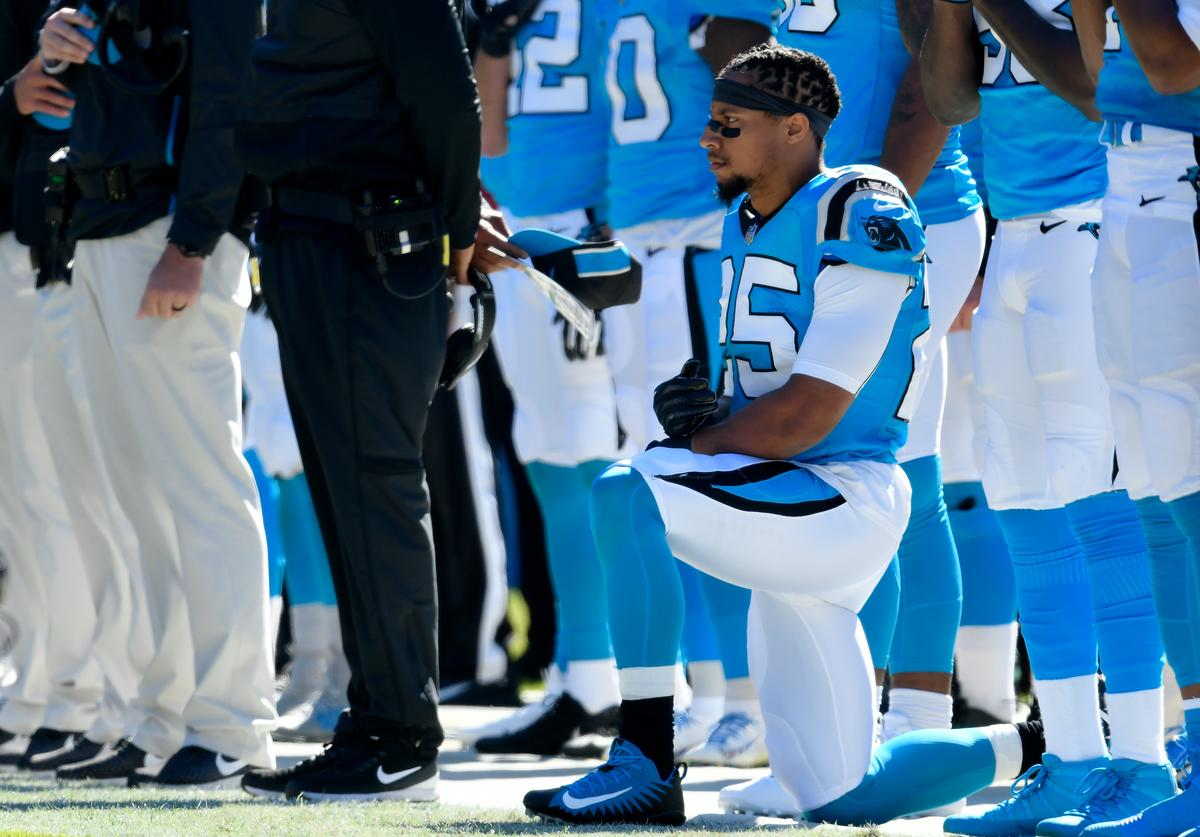Eric Reid #25 of the Carolina Panthers kneels during the anthem against the Baltimore Ravens at Bank of America Stadium on October 28, 2018 in Charlotte, North Carolina.