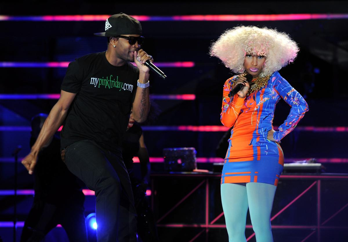 "Nicki Minaj (R) and Safaree Samuel perform onstage during ""VH1 Divas Salute the Troops"" presented by the USO at the MCAS Miramar on December 3, 2010 in Miramar, California"