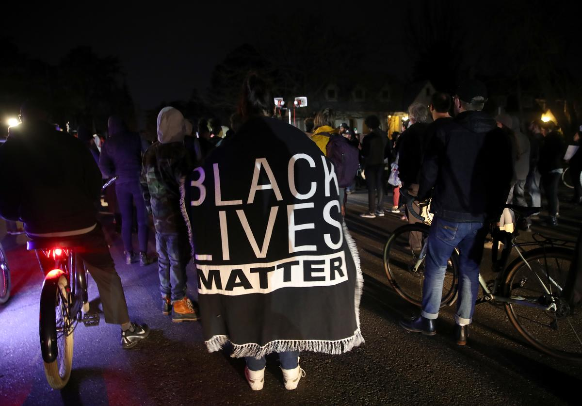 Black Lives Matter protesters march through the streets as they demonstrate the decision by Sacramento District Attorney