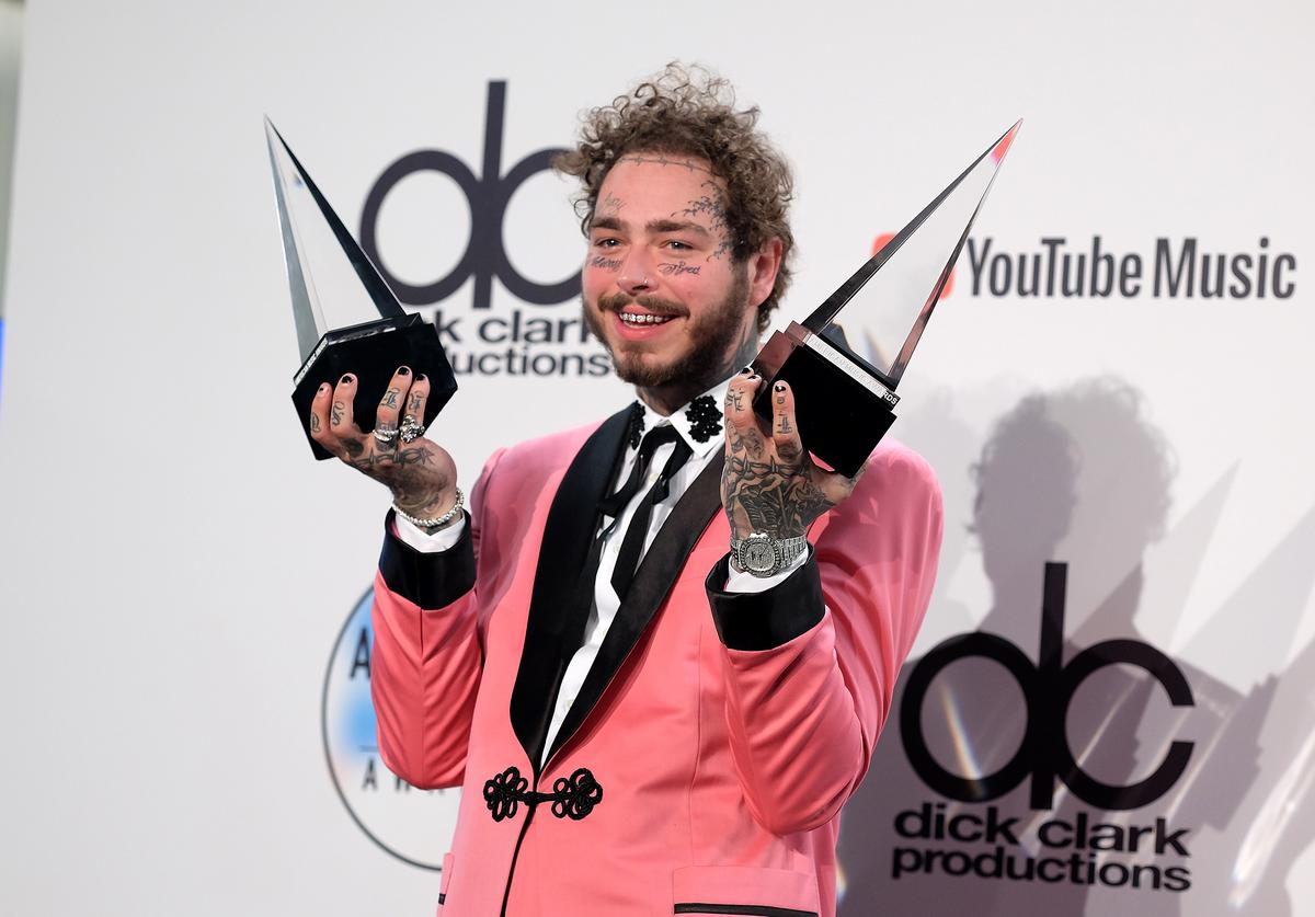 Post Malone poses in the press room during the 2018 American Music Awards at Microsoft Theater on October 9, 2018 in Los Angeles, California.