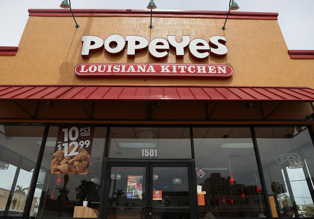 A Popeyes restaurant is seen on February 21, 2017 in Miami, Florida. Burger King and Tim Horton's owner Restaurant Brands International has announced plans on buying Popeyes Louisiana Kitchen in a deal valued at $1.8 billion.