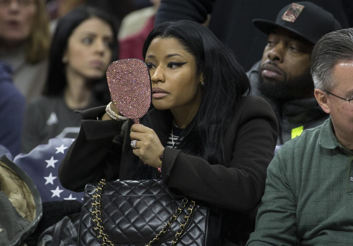 Nicki Minaj looks at herself in a mirror during the game between the Golden State Warriors and Philadelphia 76ers on January 30, 2016 at the Wells Fargo Center in Philadelphia, Pennsylvania