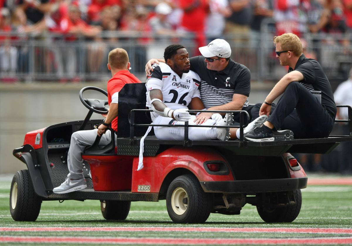 Kyriq McDonald #26 of the Cincinnati Bearcats is carted off the field after suffering an injury in the second quarter against the Ohio State Buckeyes at Ohio Stadium on September 7, 2019 in Columbus, Ohio.