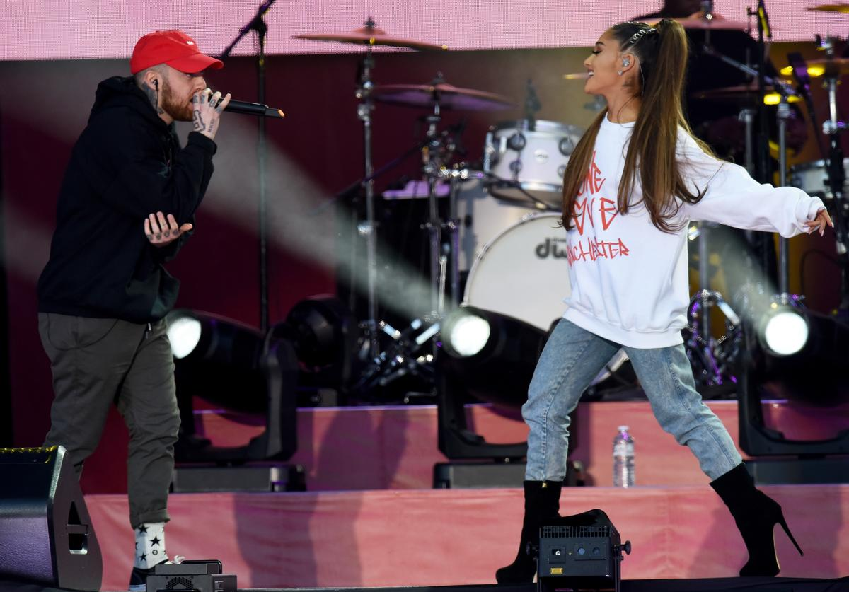 In this handout provided by 'One Love Manchester' benefit concert (L) Mac Miller and Ariana Grande perform on stage on June 4, 2017 in Manchester, England.