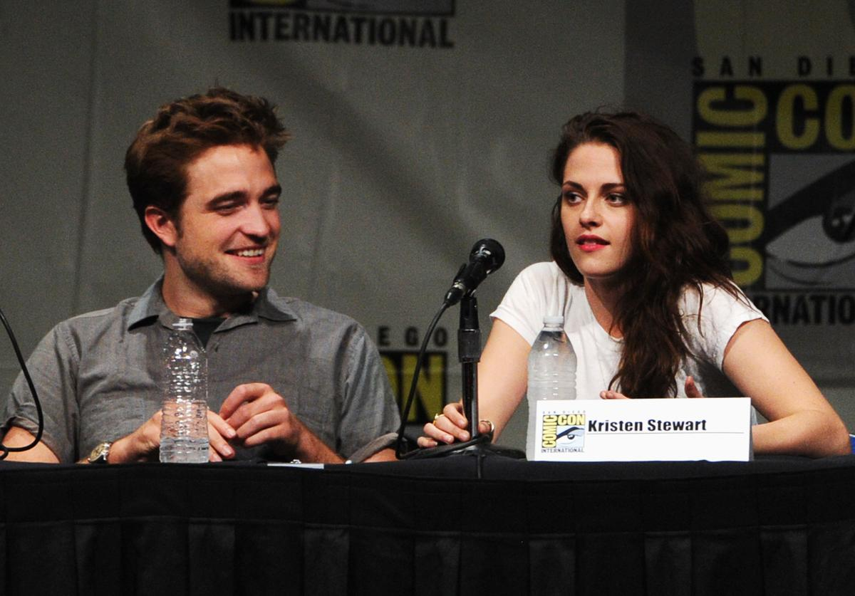 "Actors Robert Pattinson (L) and Kristen Stewart speak at ""The Twilight Saga: Breaking Dawn Part 2"" Panel during Comic-Con International 2012 at San Diego Convention Center on July 12, 2012 in San Diego, California."