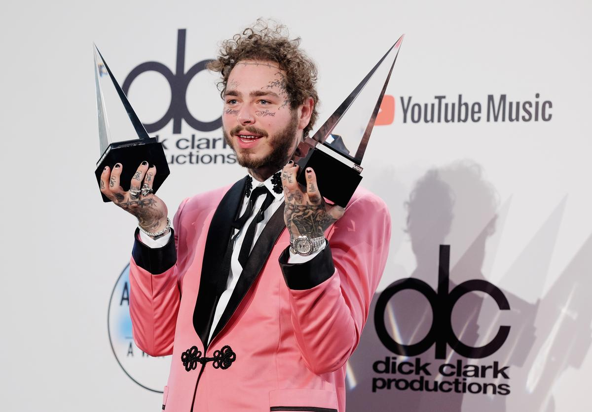 Post Malone, winner of the Favorite Male Artist - Pop/Rock award poses in the press room during the 2018 American Music Awards at Microsoft Theater on October 9, 2018 in Los Angeles, California