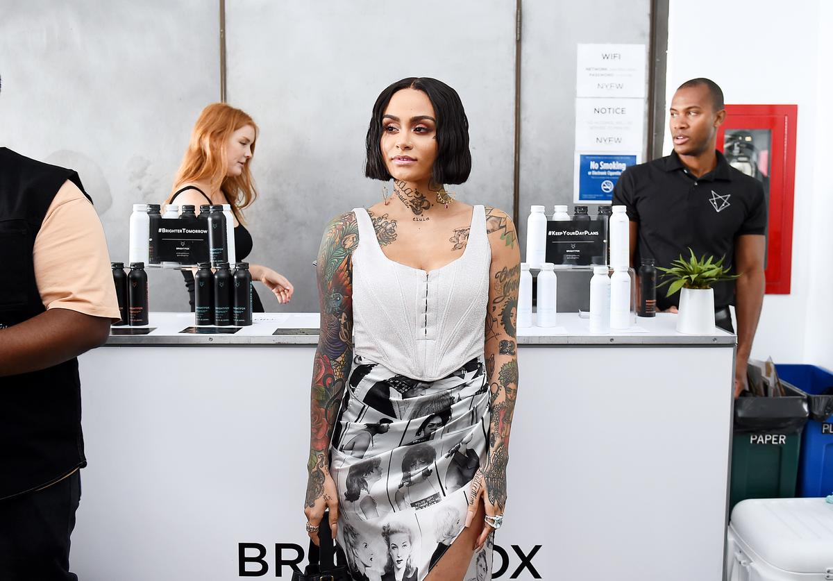 Kehlani enjoys a BrightFox beverage backstage during BrightFox at the LaQuan Smith SS20 NYFW runway show on September 08, 2019 at Pier 59 Studios in New York City