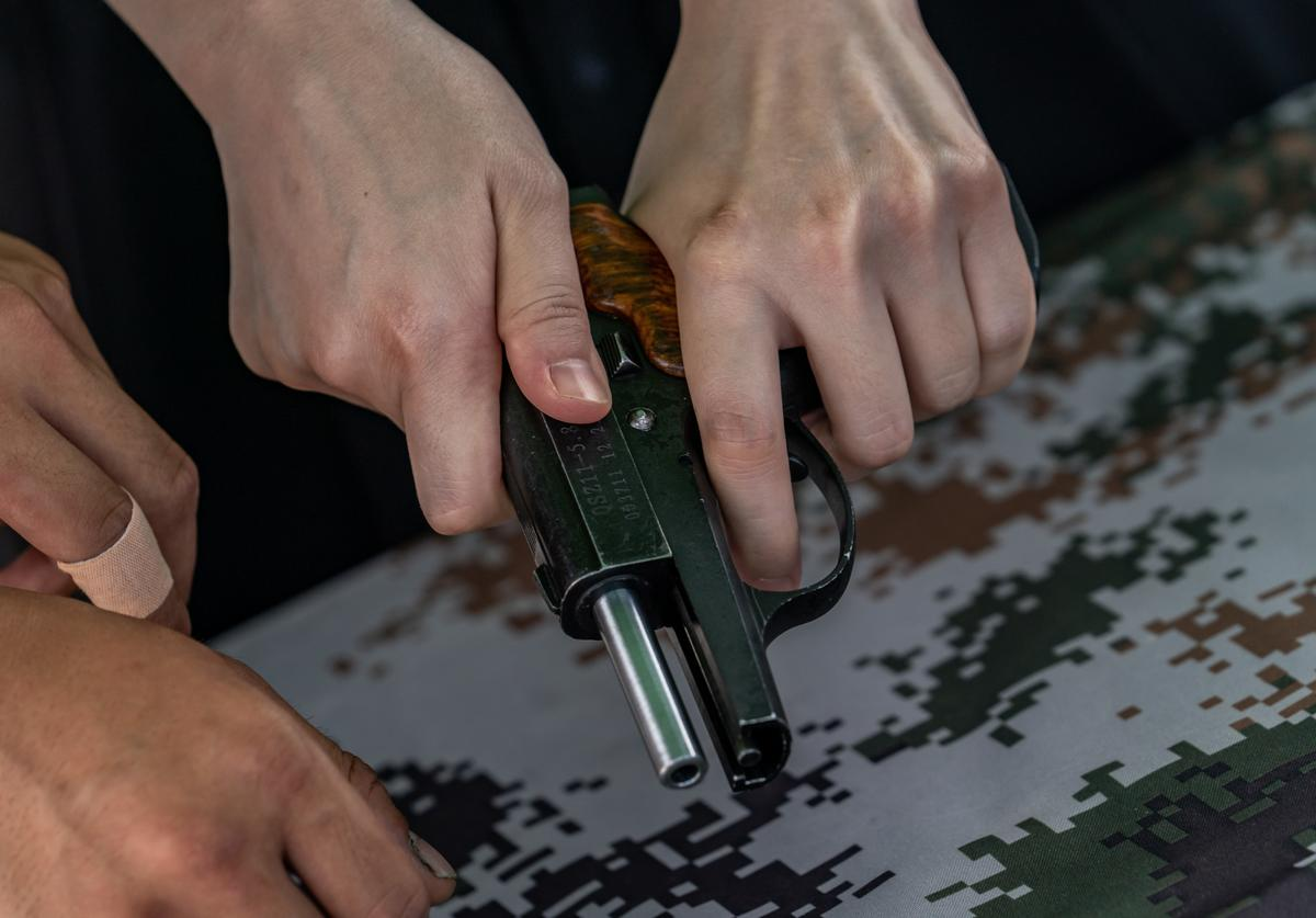 isitor holds a pistol at the Shek Kong Barracks on June 30, 2018 in Hong Kong, Hong Kong. Hong Kong will mark 21 years since its return to Chinese sovereignty from British rule on Sunday as thousands of people are expected to turn up for an annual rally to demand full democracy and vent their frustration over the soaring accommodation costs in the world's most expensive city for expatriates