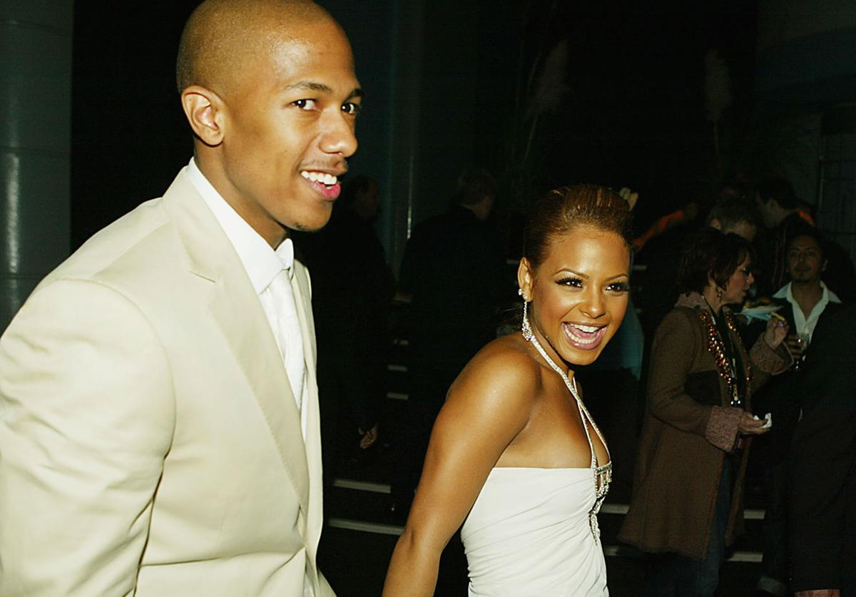 "Actors Nick Canon (L) and Christina Milian arrive at the after party for the Premiere of MGM's ""Be Cool"" at the Hollywood Palladium on February 14, 2005 in Los Angeles, California."