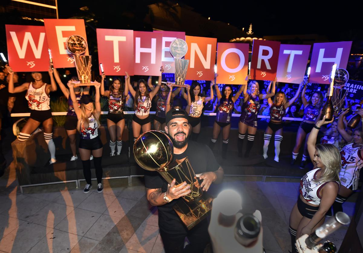 Drake carries the Larry O'Brien NBA Championship Trophy as he celebrates the Toronto Raptor's NBA championship at XS Nightclub at Wynn Las Vegas on June 14, 2019 in Las Vegas, Nevada.