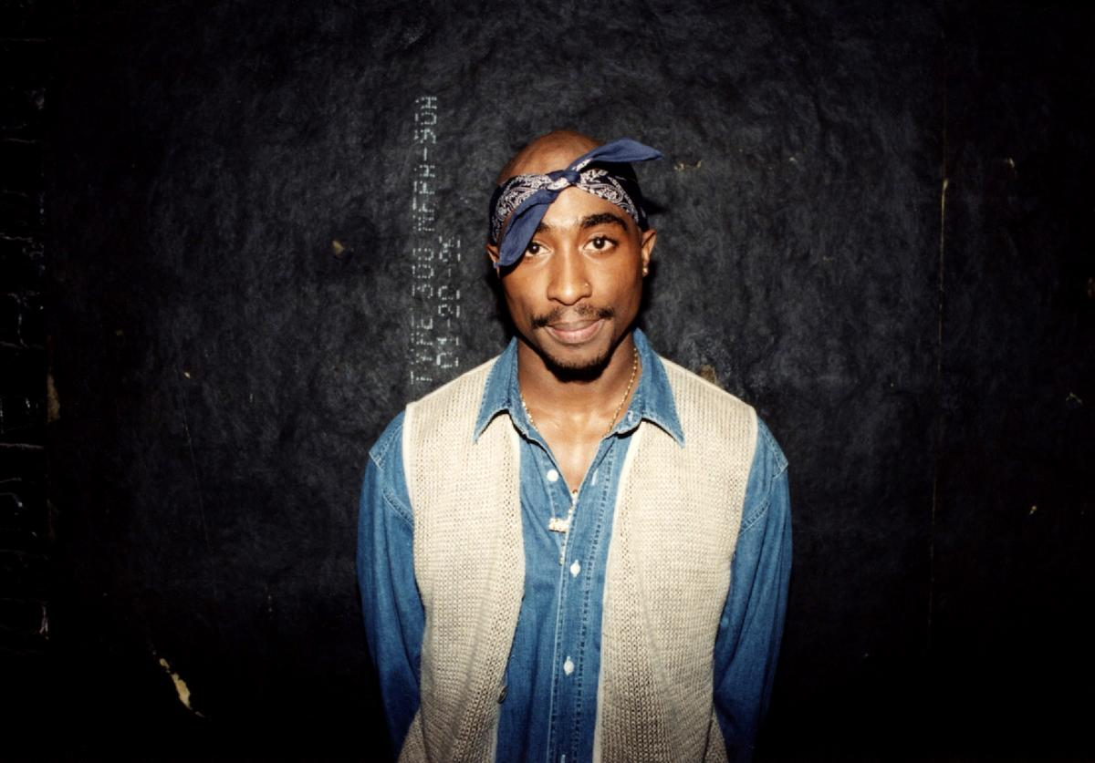 Tupac Shakur poses for photos backstage after his performance at the Regal Theater in Chicago, Illinois in March 1994
