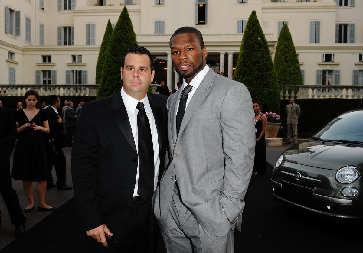 Rapper 50 Cent (R) and Randall Emmett arrives for the amfAR Cinema Against AIDS 2009 benefit at the Hotel du Cap during the 62nd Annual Cannes Film Festival on May 21, 2009 in Antibes, France.