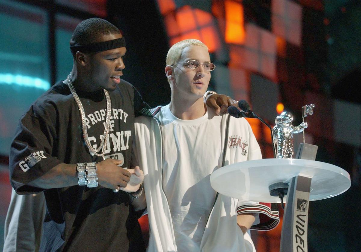50 Cent (L) congratulates Eminem for receiving the award for Best Video From A Film during the 2003 MTV Video Music Awards at Radio City Music Hall on August 28, 2003 in New York City