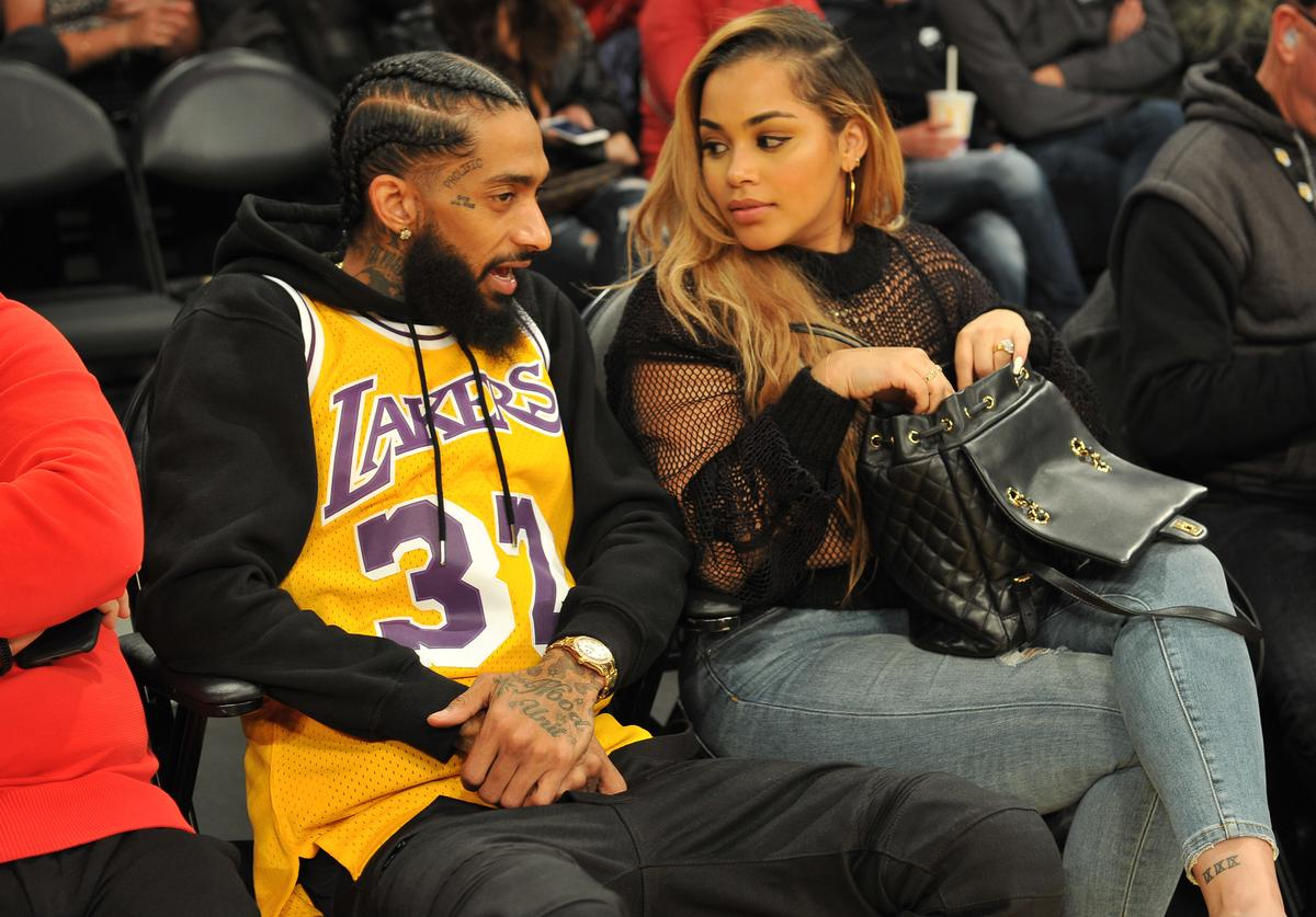 Nipsey Hussle and Lauren London attend a basketball game between the Los Angeles Lakers and the Minnesota Timberwolves at Staples Center on December 25, 2017 in Los Angeles, California