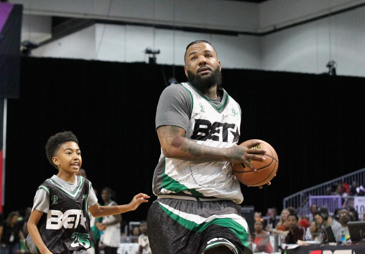 Miles Brown (L) and The Game play basketball at the Celebrity Basketball Game Sponsored By Sprite during the 2018 BET Experience at Los Angeles Convention Center on June 23, 2018 in Los Angeles, California