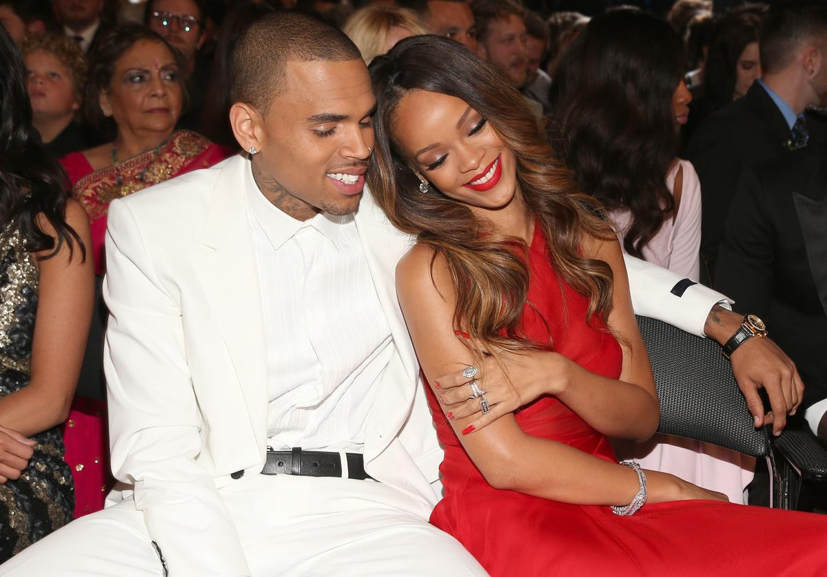 Chris Brown (L) and Rihanna attend the 55th Annual GRAMMY Awards at STAPLES Center on February 10, 2013 in Los Angeles, California