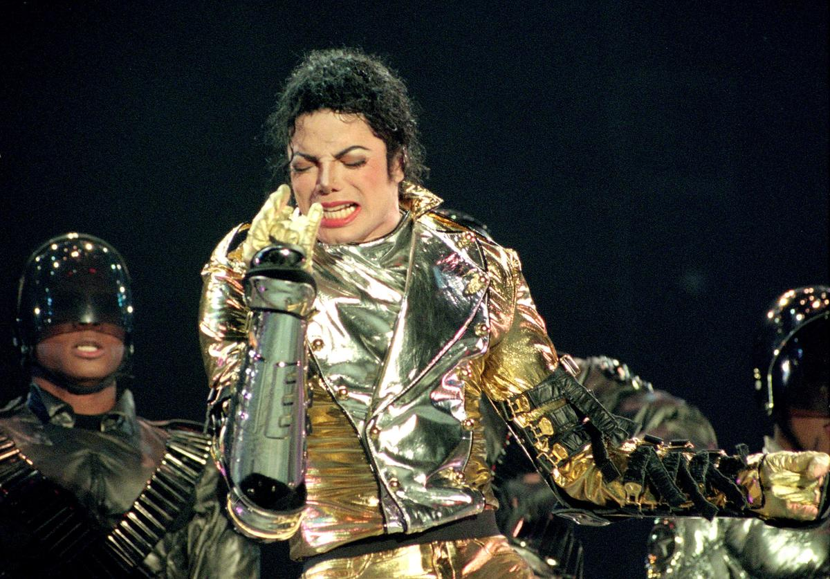 """Michael Jackson performs on stage during is """"HIStory"""" world tour concert at Ericsson Stadium November 10, 1996 in Auckland, New Zealand"""