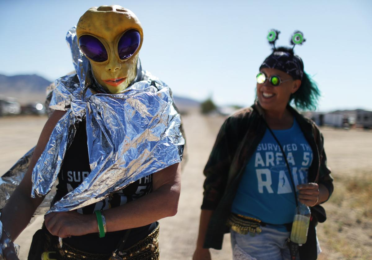 Margaret Lemay (L) and Karen Peterson of Wisconsin gather at a 'Storm Area 51' spinoff event on September 20, 2019 in Rachel, Nevada. The event is a spinoff from the original 'Storm Area 51' Facebook event which jokingly encouraged participants to storm the famously secretive Area 51 military base in order to 'see them aliens'. Two tiny desert towns not far from from the once-secret Area 51 are hosting related events this weekend. The military has warned attendees not to approach the protected Area 51 military installation.