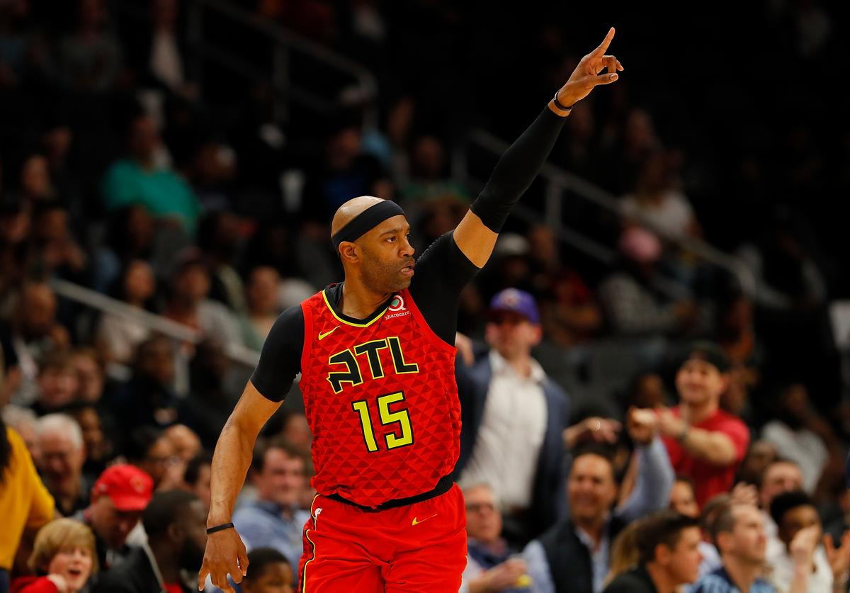Vince Carter #15 of the Atlanta Hawks reacts after hitting a three-point basket against the Memphis Grizzlies in the first half at State Farm Arena on March 13, 2019 in Atlanta, Georgia.
