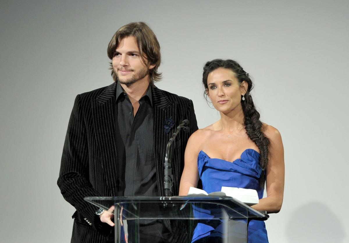 Actors Ashton Kutcher (L) and Demi Moore speak onstage at the 13th Annual Costume Designers Guild Awards with presenting sponsor Lacoste held at The Beverly Hilton hotel on February 22, 2011 in Beverly Hills, California.