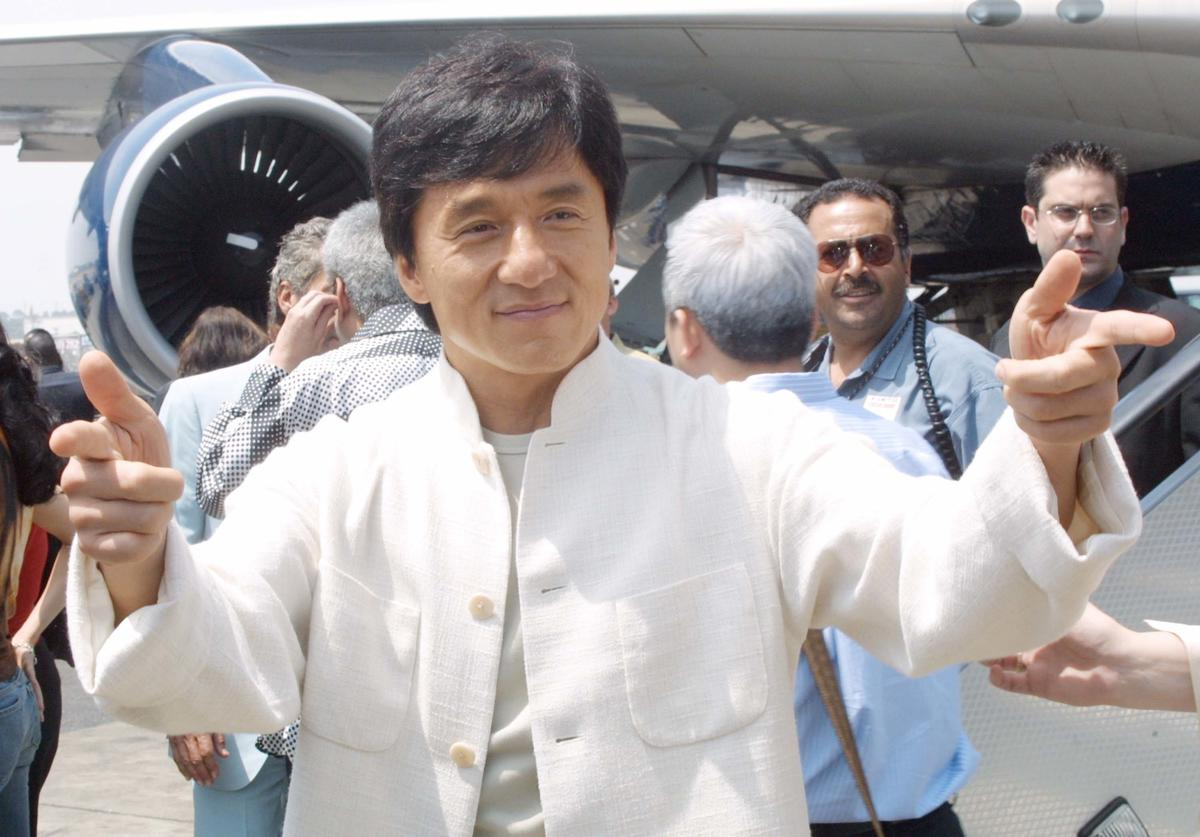"""Actor Jackie Chan arrives at the launch of United Airlines """"Rush Hour Express"""" July 26, 2001 in Los Angeles, CA."""