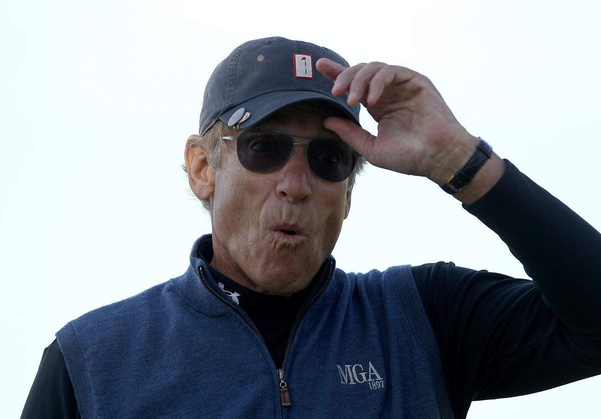 Maury Povich reacts to making a putt on the 5th hole during the final round of the AT&T Pebble Beach National Pro-Am at the Pebble Beach Golf Links on February 13, 2011 in Pebble Beach, California