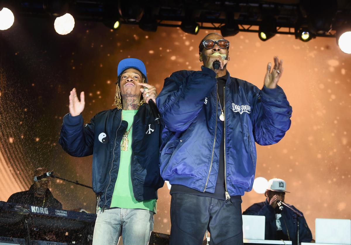 Wiz Khalifa and Snoop Dog perform onstage at the AOL NewFront 2016 at Seaport District NYC on May 3, 2016 in New York City