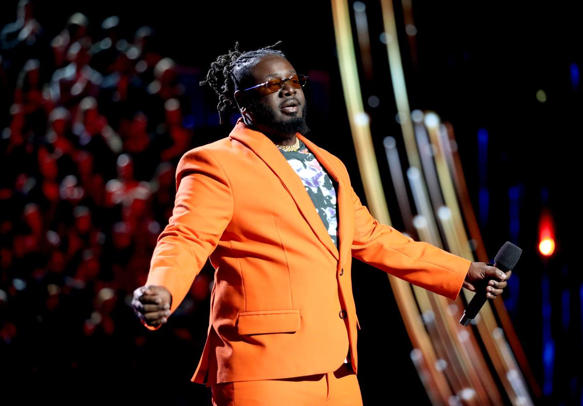 T-Pain speaks on stage at the 2019 iHeartRadio Music Awards which broadcasted live on FOX at the Microsoft Theater on March 14, 2019 in Los Angeles, California.
