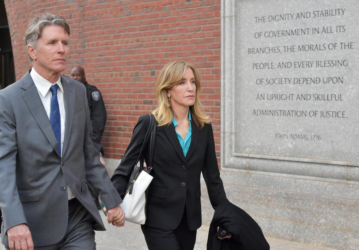 Felicity Huffman exits the John Joseph Moakley U.S. Courthouse after appearing in Federal Court to answer charges stemming from college admissions scandal on April 3, 2019 in Boston, Massachusetts.