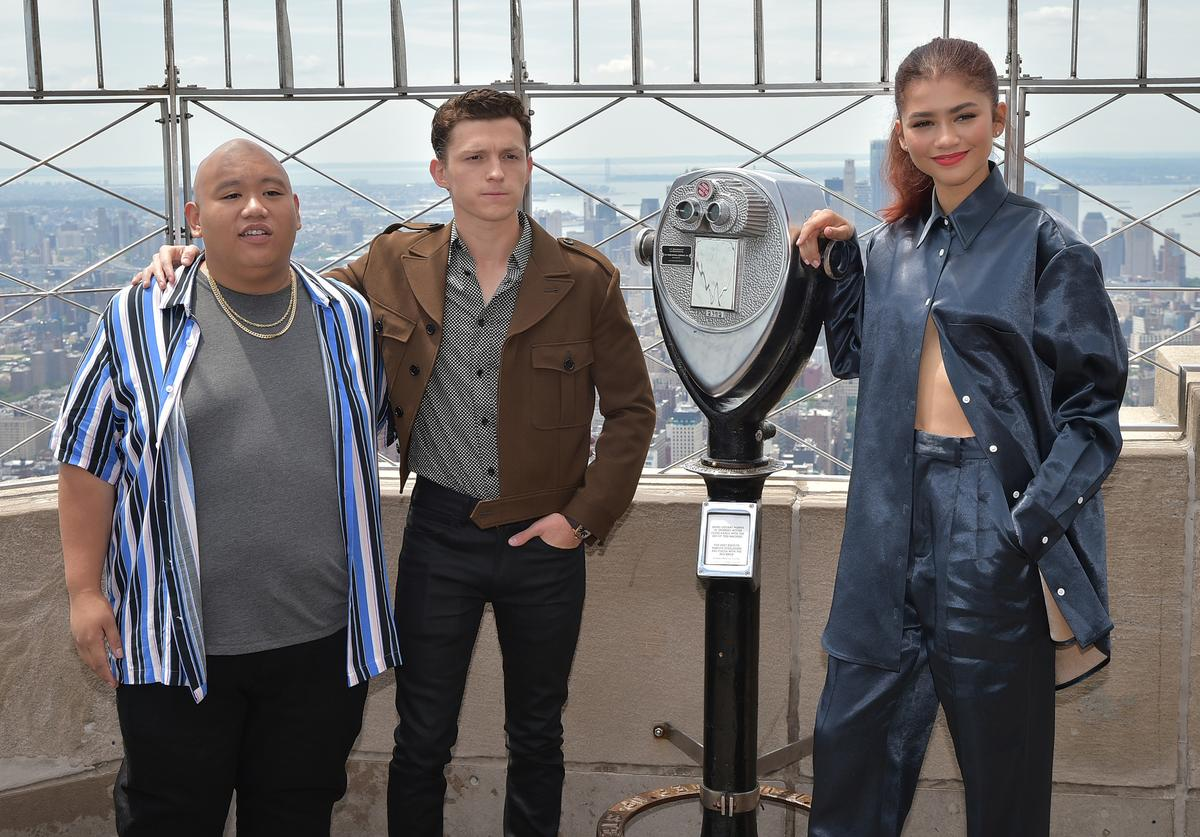 "Jacob Batalon, Tom Holland and Zendaya attend as Stars Of ""Spider-Man: Far From Home"" Light The Empire State Building at The Empire State Building on June 24, 2019 in New York City."