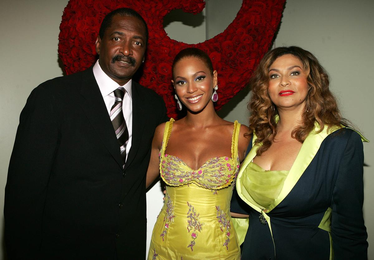 """Beyonce Knowles (C) poses with her father and manager Matthew Knowles and her mother Tina Knowles at the """"Beyonce: Beyond the Red Carpet auction presented by Beyonce and her mother Tina Knowles along with the House of Dereon to benefit the VH1 Save The Music Foundation June 23, 2005 in New York City"""