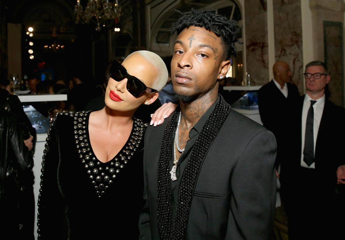 "Amber Rose (L) and 21 Savage attend Harper's BAZAAR Celebration of ""ICONS By Carine Roitfeld"" at The Plaza Hotel presented by Infor, Laura Mercier, Stella Artois, FUJIFILM and SWAROVSKI on September 8, 2017 in New York City"