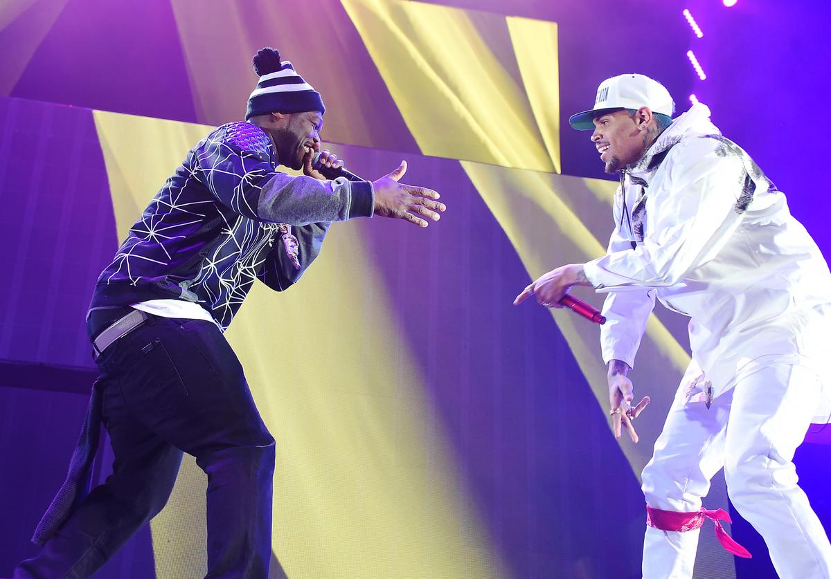 """50 Cent (L) and Chris Brown perform onstage during the """"Between The Sheets"""" tour at Barclays Center of Brooklyn on February 16, 2015 in New York City"""