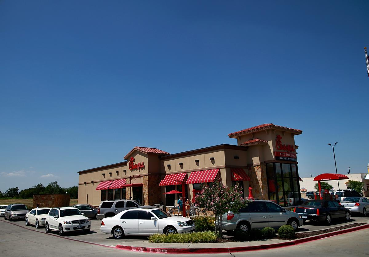 Drive through customers wait in line at a Chick-fil-A restaurant on August 1, 2012 in Fort Worth, Texas
