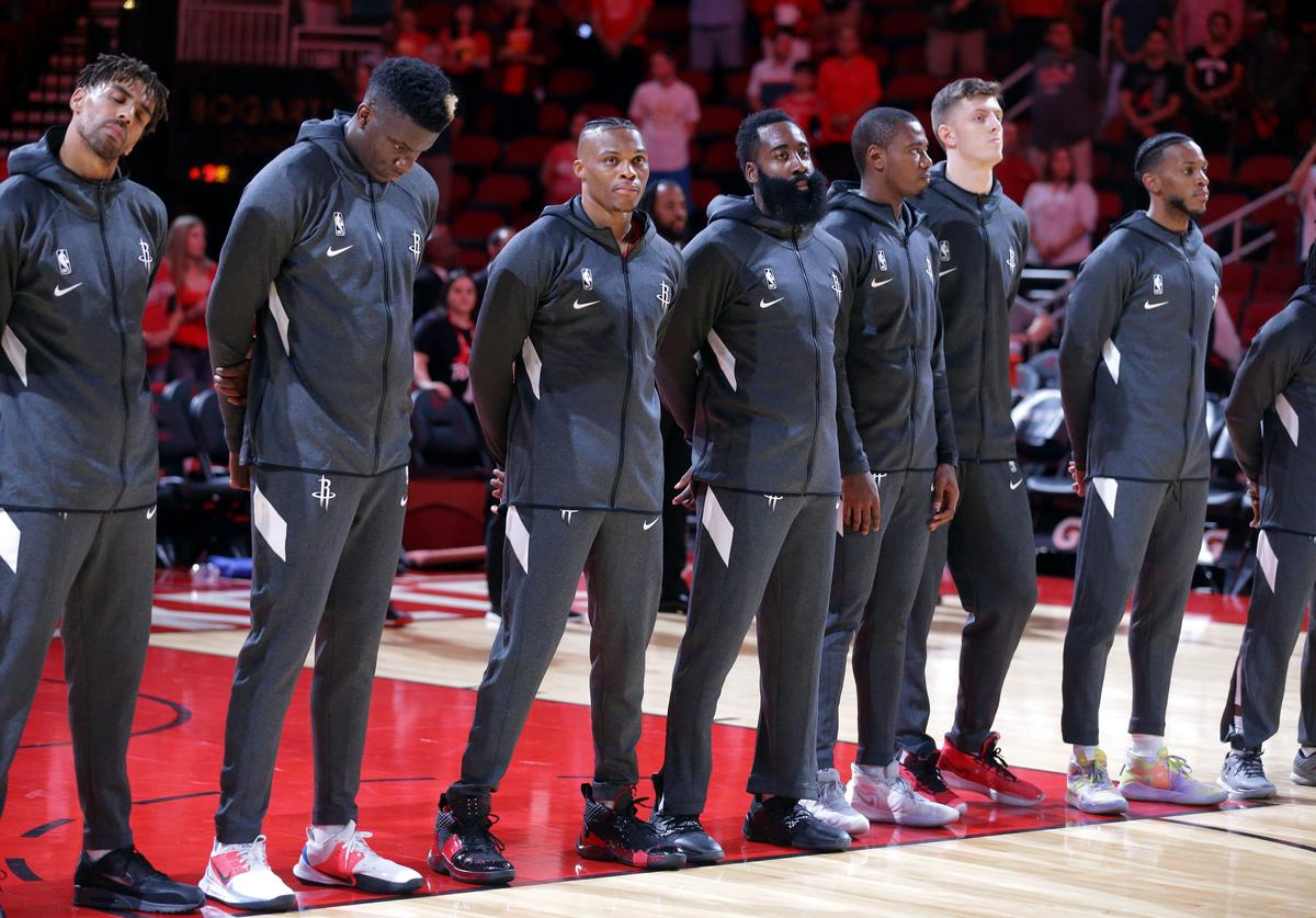 Houston Rockets during the National Anthem before playing the Shanghai Sharks at Toyota Center on September 30, 2019 in Houston, Texas.