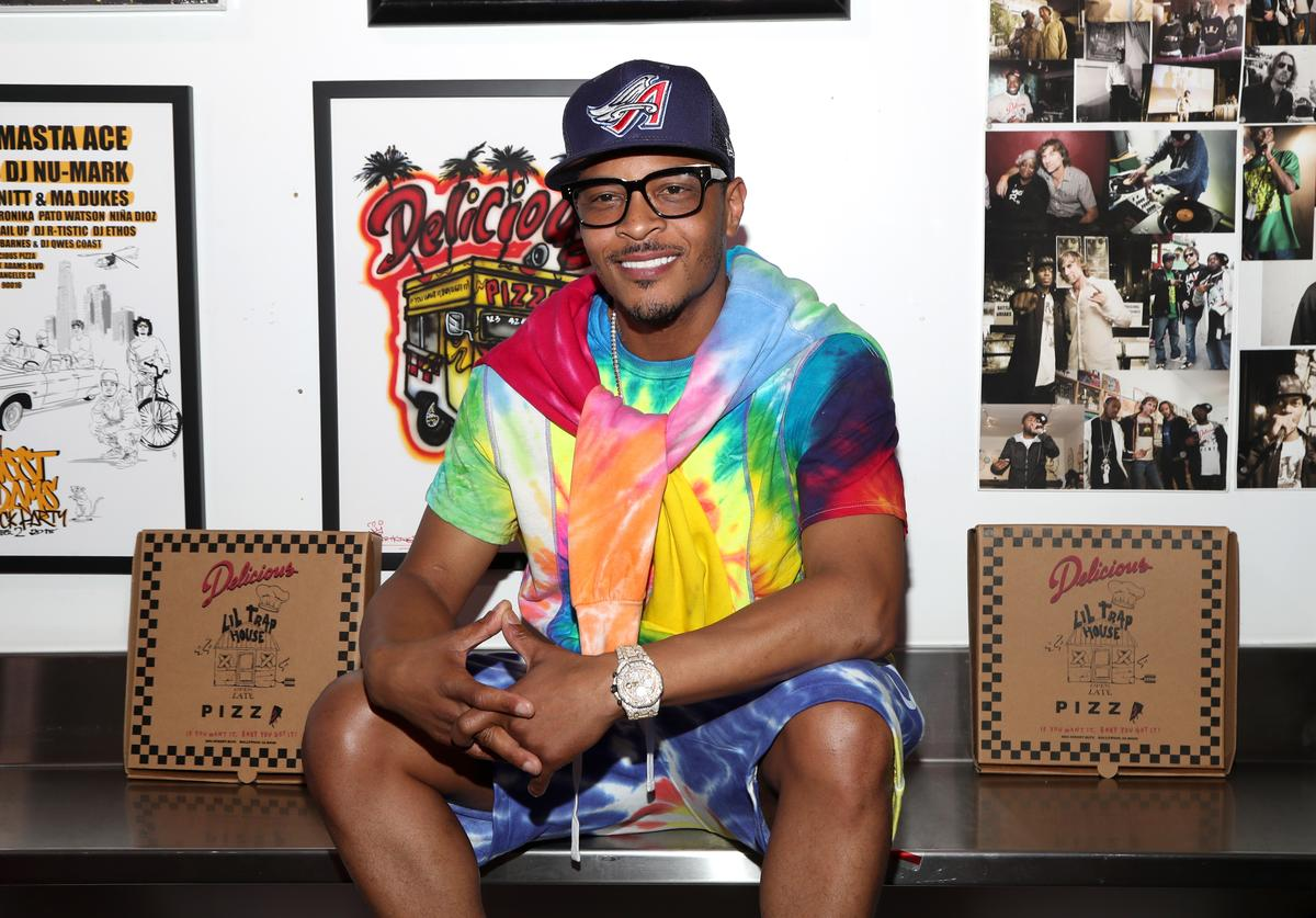 T.I. poses inside of Delicious Pizza during the Launch of the Lil Trap House at the Lil Trap House Exhibition at Delicious Pizza on July 12, 2019 in Los Angeles, California