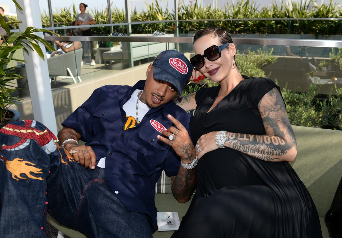 "Alexander ""AE"" Edwards (L) and Amber Rose attend The Def Jam Recordings BETX celebration at Spring Place Beverly Hills in partnership with Puma, Courvoisier, Beats, and Heineken on June 22, 2019 in Beverly Hills, California."