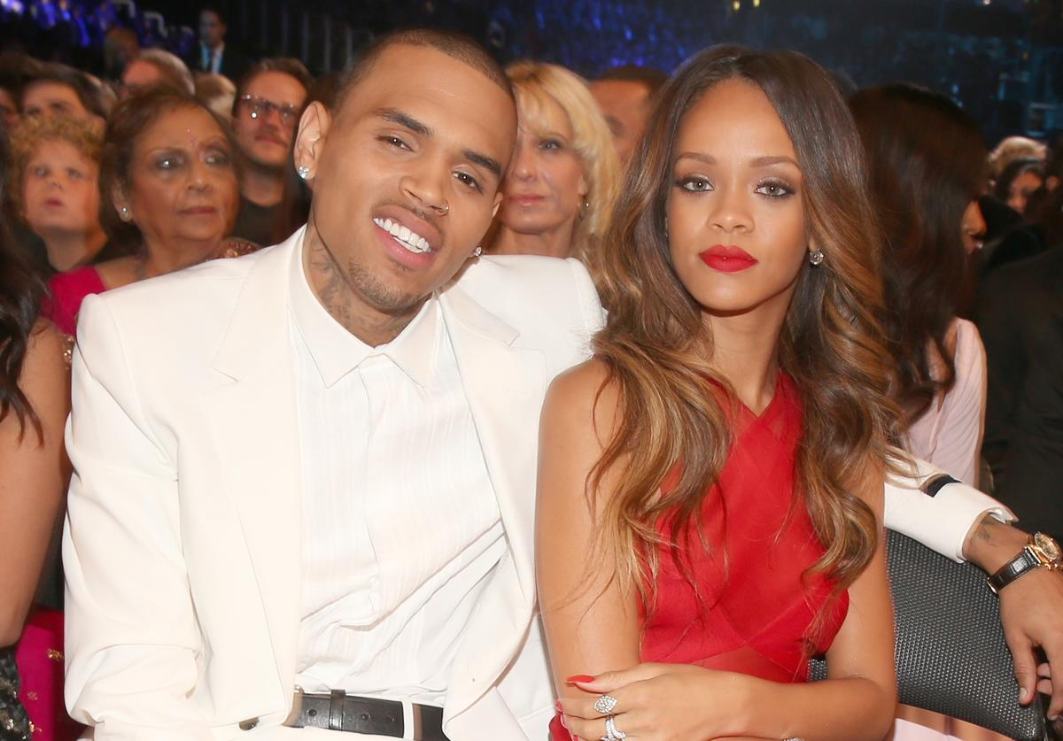 ingers Chris Brown (L) and Rihanna attend the 55th Annual GRAMMY Awards at STAPLES Center on February 10, 2013 in Los Angeles, California.