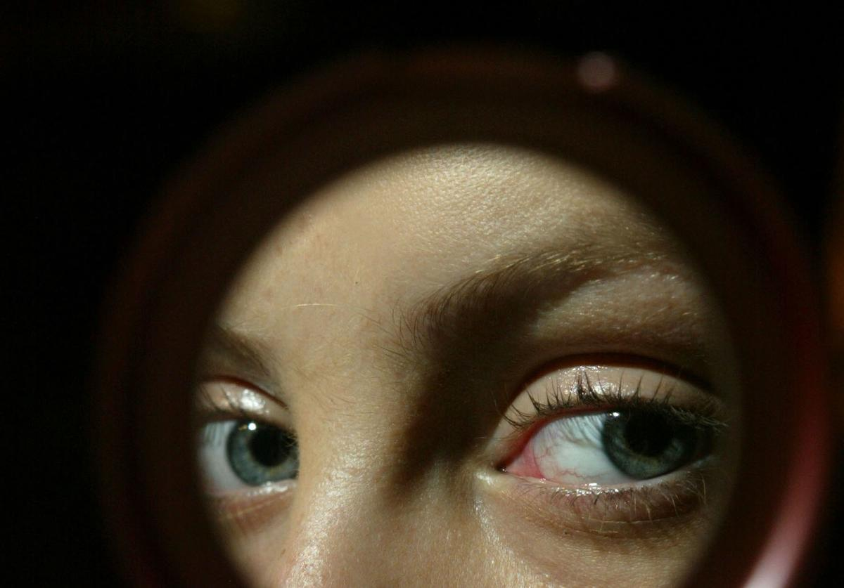 A model's eyes are seen in a reflection at the Cynthia Steffe show during Olympus Fashion Week Spring 2005