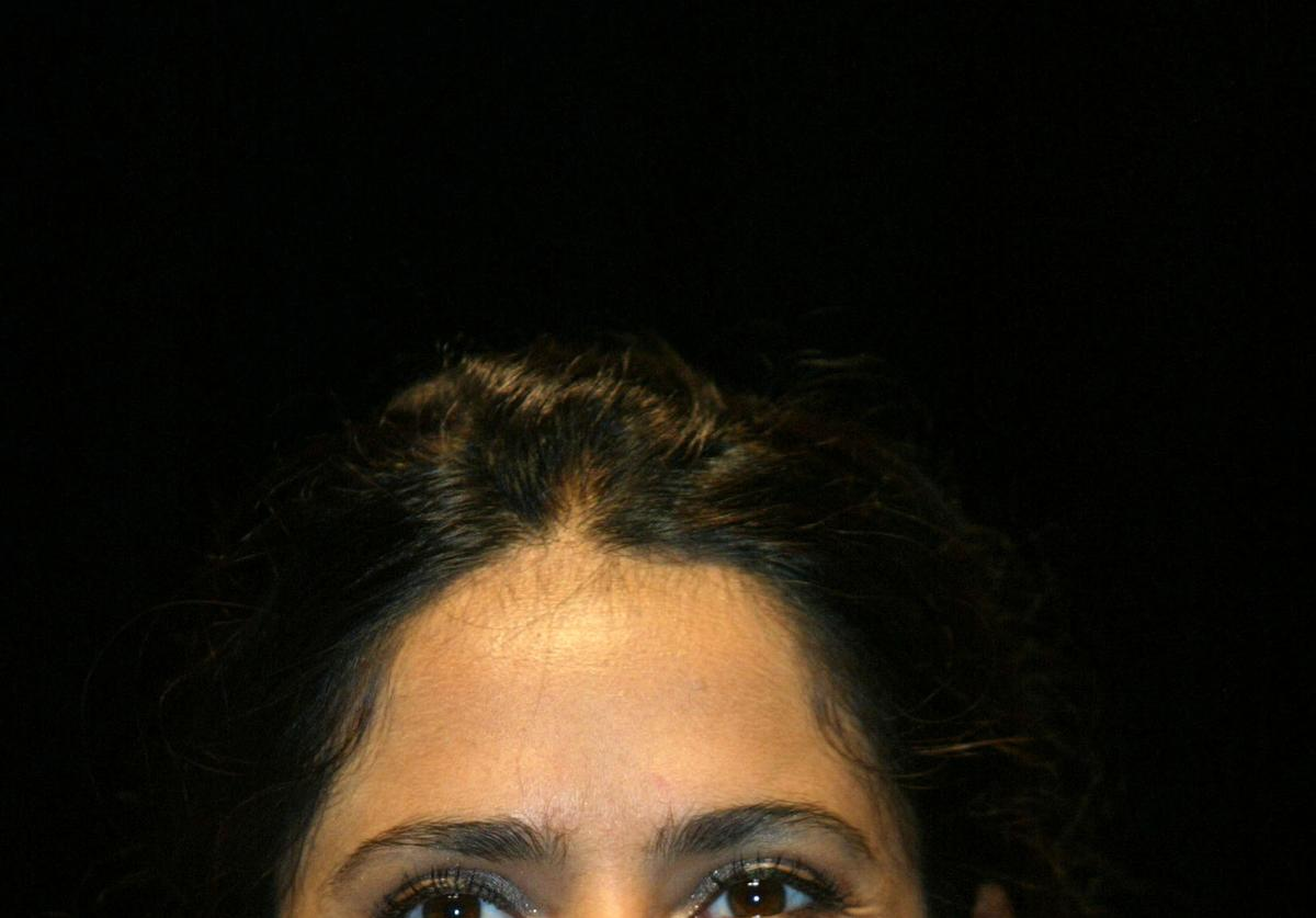 """Actress Salma Hayek attends a news conference during the premiere of the film """"Frida"""""""