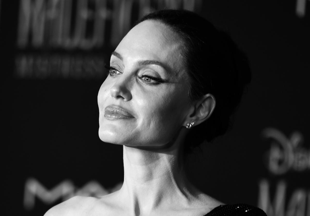 "Editor's Note; Image converted to black and white) Angelina Jolie attends the World Premiere Of Disney's ""Maleficent: Mistress Of Evil"" - Red Carpet at El Capitan Theatre on September 30, 2019 in Los Angeles, California."