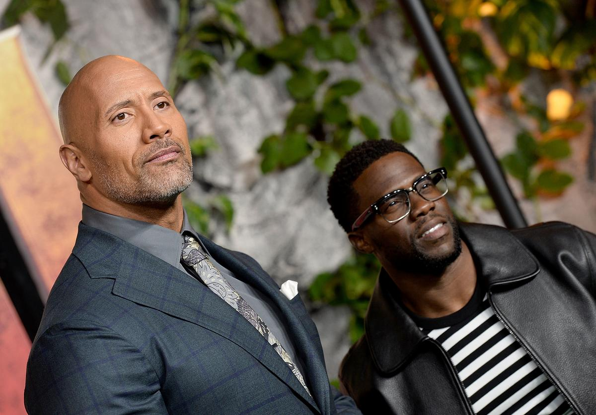 Dwayne Johnson (L) and Kevin Hart attend the 'Jumanji: Welcome To The Jungle' UK premiere held at Vue West End