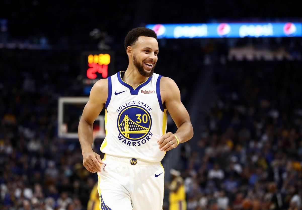 Stephen Curry #30 of the Golden State Warriors smiles during their game against the Los Angeles Lakers at Chase Center on October 05, 2019 in San Francisco, California. NOTE TO USER: User expressly acknowledges and agrees that, by downloading and or using this photograph, User is consenting to the terms and conditions of the Getty Images License Agreement.