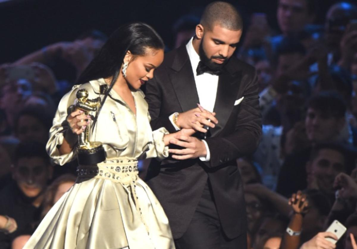 Drake presents the Video Vanguard award to Rihanna onstage during the 2016 MTV Music Video Awards