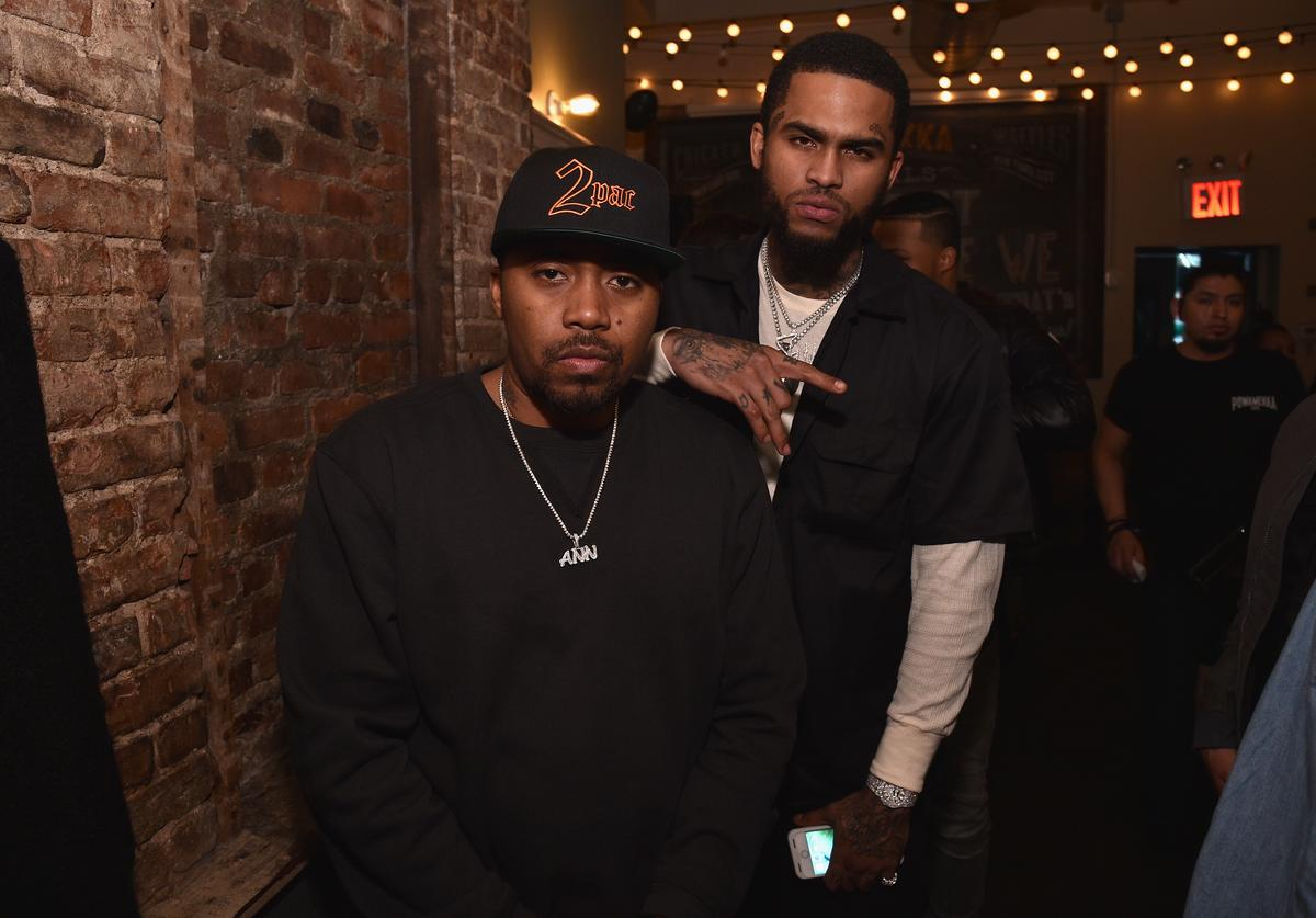 Rapper Nas and rapper Dave East attend the celebration of Tupac's Powamekka Cafe and preview of Tupac by Vlone on April 6, 2017 in New York City.