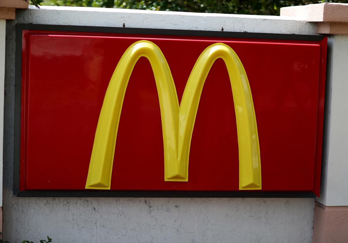 A McDonald's sign is seen as protesters ask that the hamburger chain raise its wages to $15 an hour on April 2, 2015 in Miramar, Florida. The protesters, some of whom work for McDonalds, held the event a day after McDonald's announced a pay increase of at least $1 an hour more than the minimum wage set by local law for some of its workforce.