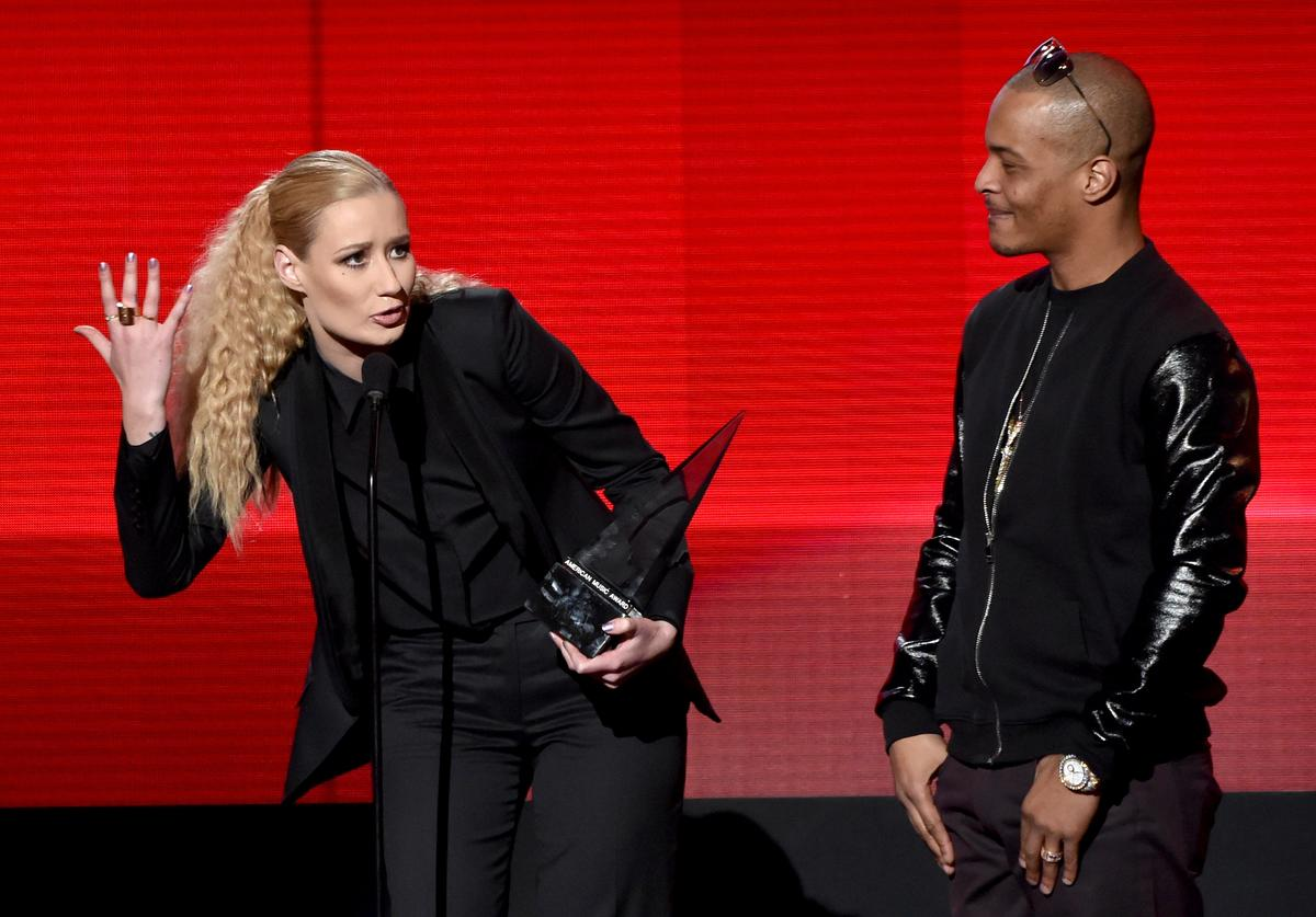 Recording artist Iggy Azalea (L) and T.I. accept the Favorite Rap/Hip-Hop Album award for 'The New Classic' onstage at the 2014 American Music Awards at Nokia Theatre L.A. Live on November 23, 2014 in Los Angeles, California.