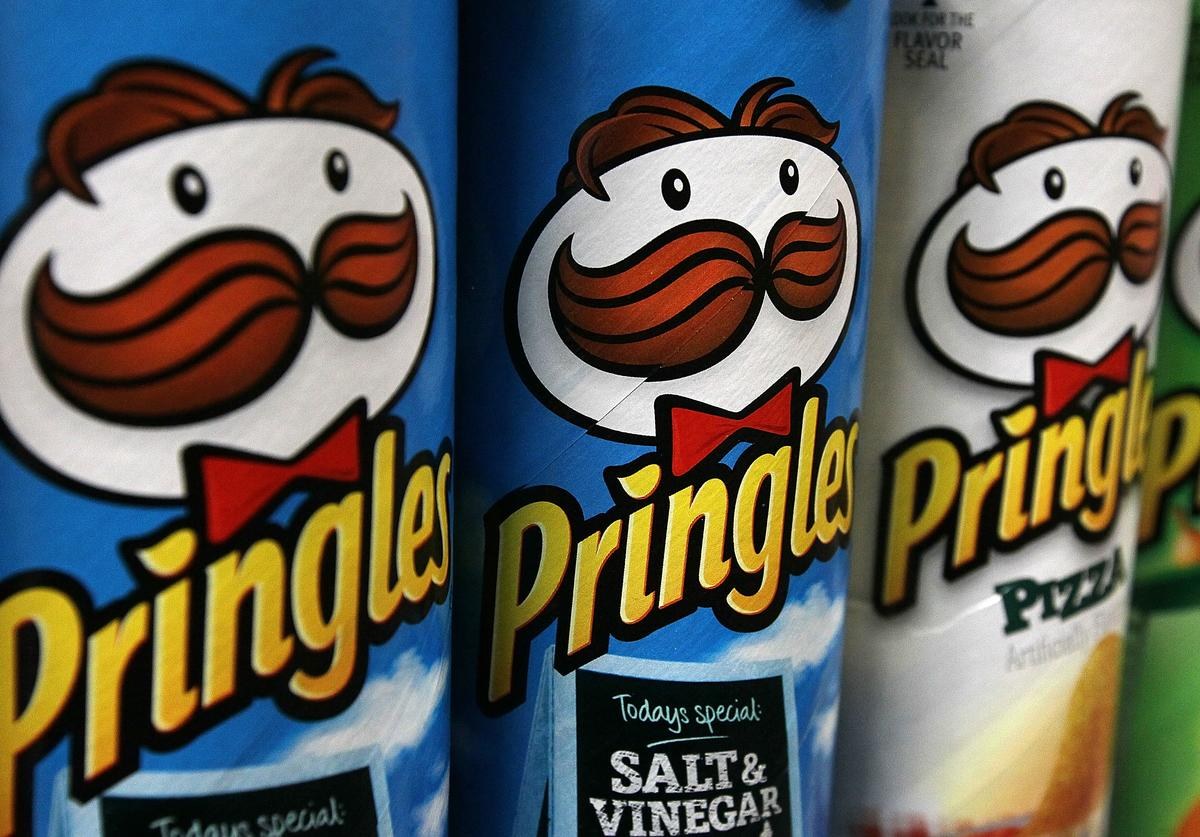 Packages of Pringles potato chips are displayed on a shelf at a market on April 5, 2011 in San Francisco, California