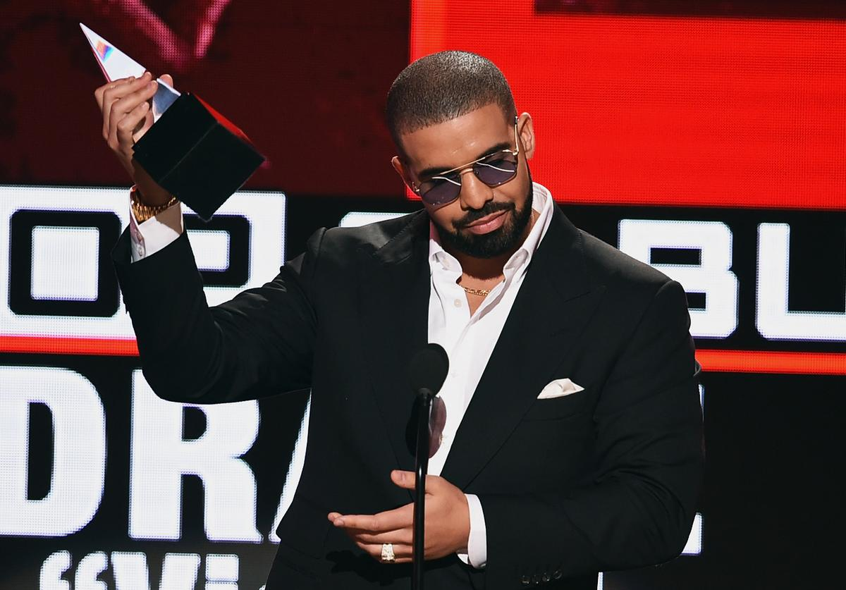 Drake accepts Favorite Rap/Hip-Hop Album for 'Views' onstage during the 2016 American Music Awards at Microsoft Theater on November 20, 2016 in Los Angeles, California